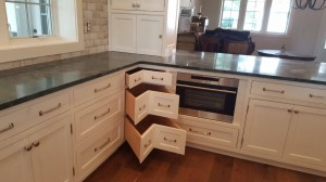 White painted cabinets with corner drawers