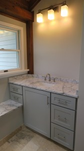 Left-side light gray vanity cabinets