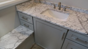 Close up of lest-side light gray vanity cabinets