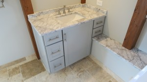 Right-side light gray vanity cabinet
