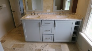 Front view of right-side light gray vanity cabinet