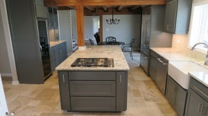 Farm sink view with gray cabinets