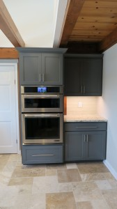 Oven with surrounding gray cabinet
