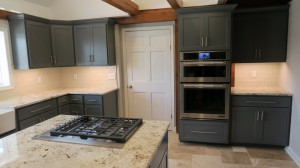 Oven with surrounding gray cabinets